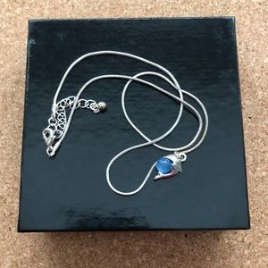 Silver dolphin necklace with lilac gem stone.